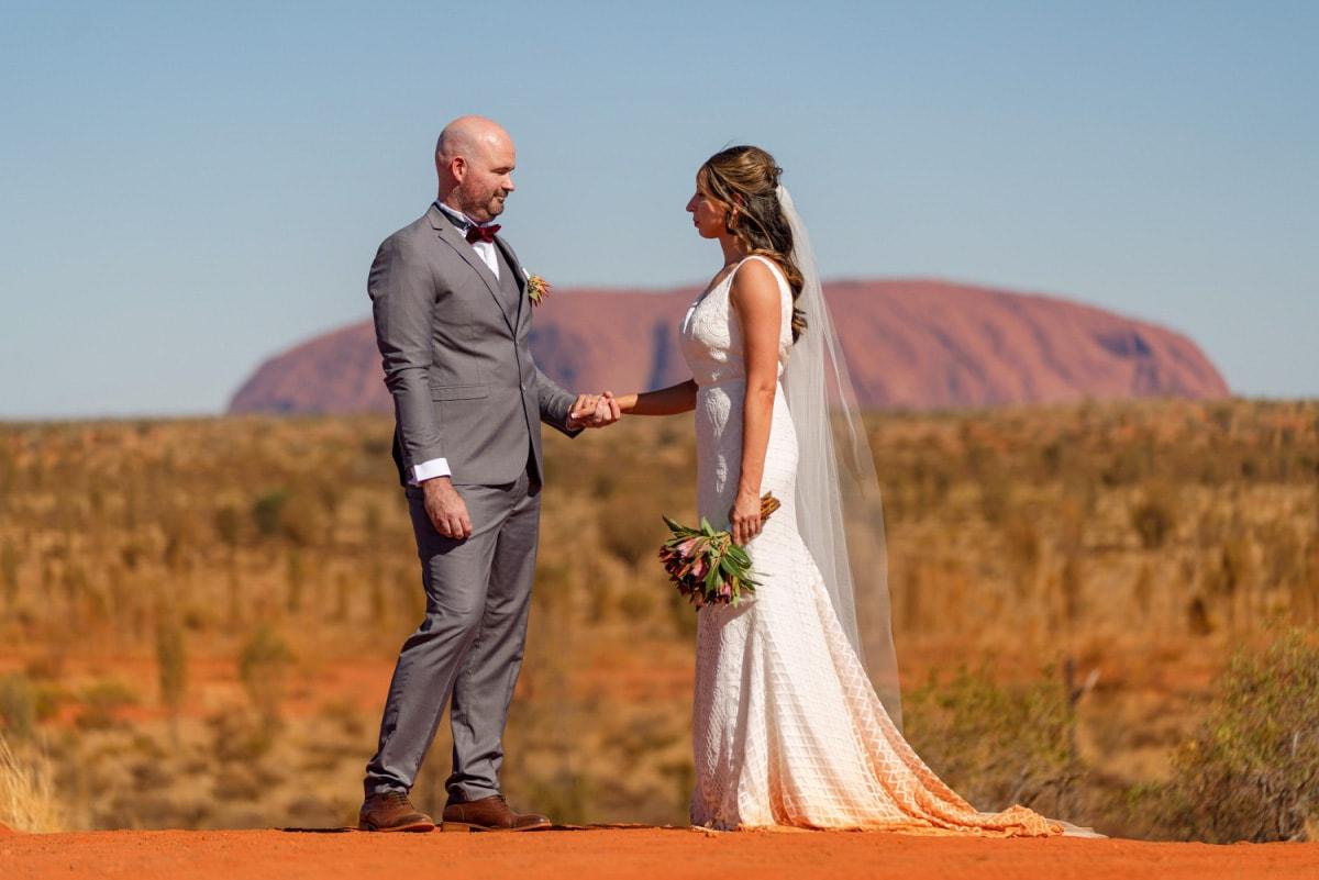 bride and groom wedding ceremony at uluru